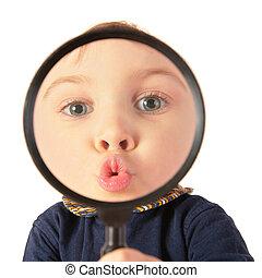 Child kiss through magnifier