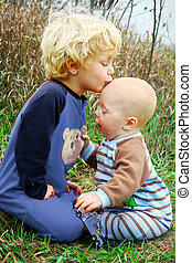Child Kissing Baby Brother