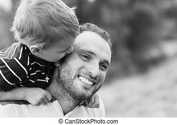 Child kissing father