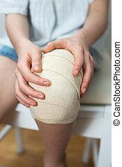 Child knee with elastic bandage on it.