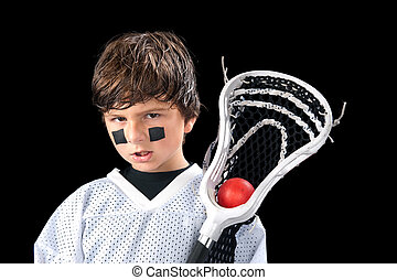 Child Lacrosse Player - A sweaty young boy poses with his...