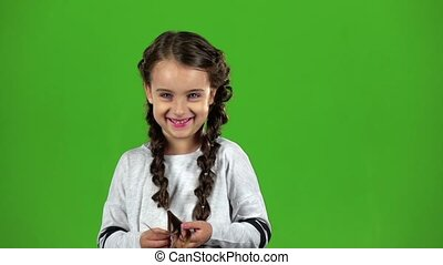 Child laughs gaily. Green screen. Slow motion