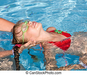 Child learn swim in swimming pool. - Instructor girl learn...