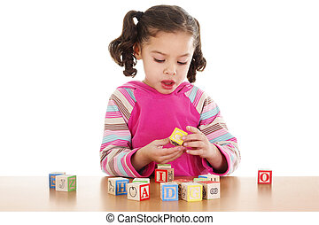Child Learning - Stock image of child playing with cube...