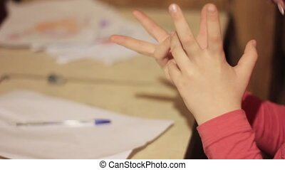 child learns to count, delicate learning future bright generation. close-up baby hands