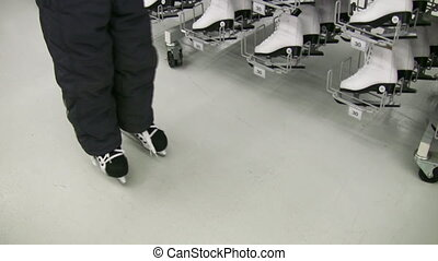 child legs with skates in shop - Child legs with skates in...
