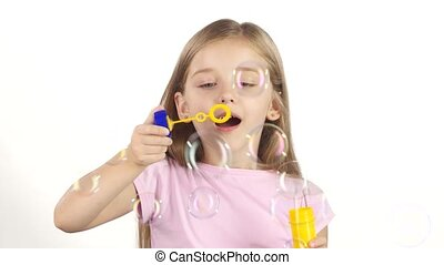 Child lets the soap bubbles. White background