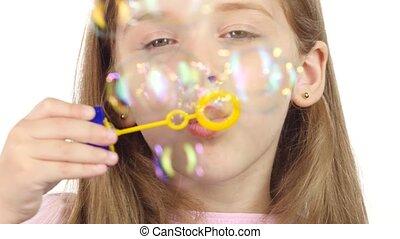 Child lets the soap bubbles. White background. Close up