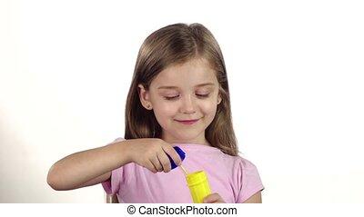 Child lets the soap bubbles. White background. Slow motion