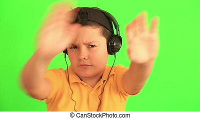 Child listening to music and dancing
