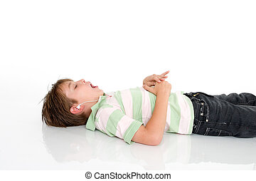 Child listing to music - Child lying down listening to mp3 ...
