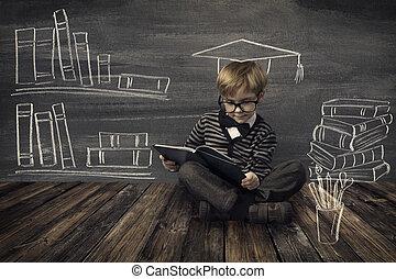 Child Little Boy in Glasses Reading Book over School Black Board