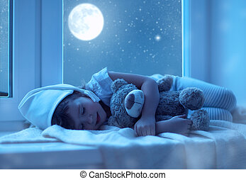 child little girl sleeping at window dreaming and admiring...