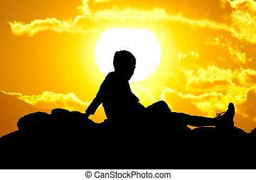 child look the sunset