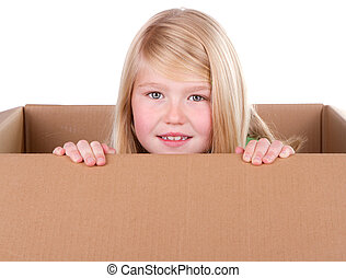 Child looking out of a box