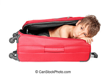 Child looking out red suitcase. Isolated on white