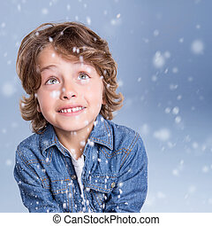 Child looking snow