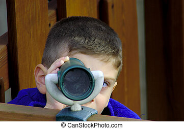 Child Looking Through Scope