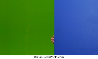 Child looks out from behind an empty board. Green screen -...