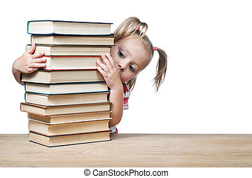 Child looks out from behind the books