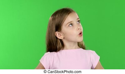 Child looks with great surprise around. Green screen