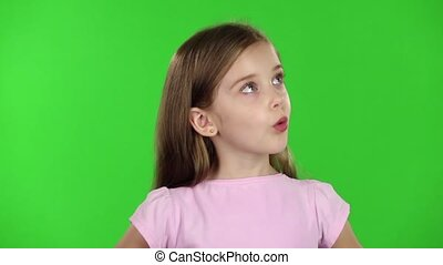 Child looks with great surprise around. Green screen. Slow...