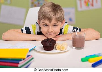 Child loving sweet unhealthy food