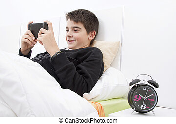 child lying down with the telephone phone in the room