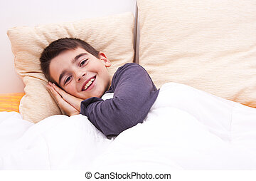 child lying in bed