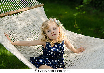child lying in hammock
