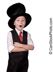 Child Magician - Young boy dressed as a magician with a hat...