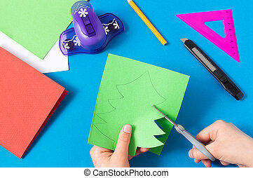 Child makes card with Christmas tree. Step 4
