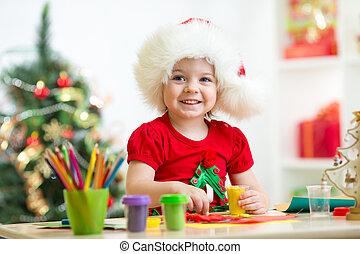 child making christmas tree of plasticine