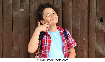 Child making funny silly faces - Young boy making funny...