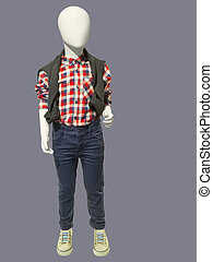 Child mannequin dressed in plaid shirt and jeans