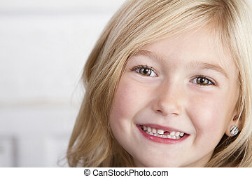 Child missing front tooth - Close up of child missing her...