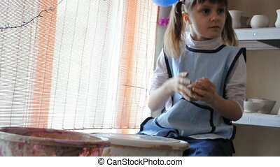 child molding clay
