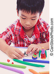 Child moulding whale modeling clay, on white background. -...
