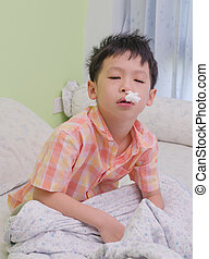 Child nose wiping with tissue