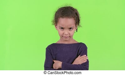 Child of an african american is angry. Green screen - Child...