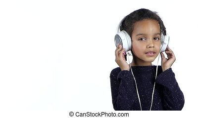 Child of an african american listens to the music in the...