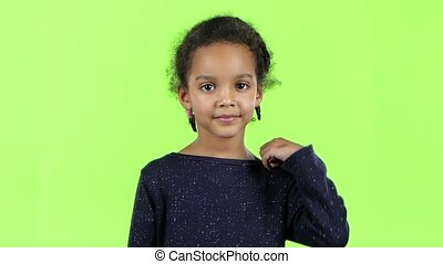 Child of an african american shows thumbs up. Green screen....