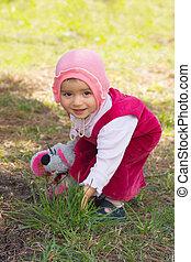 child on a grass