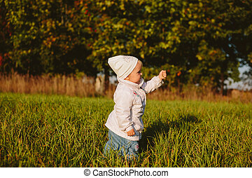 Child on a green meadow