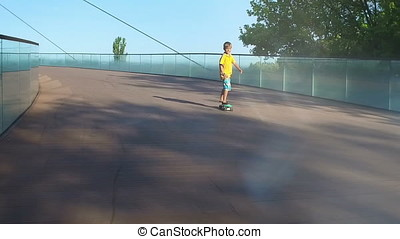 Child on a pennyboard, flares, slow motion