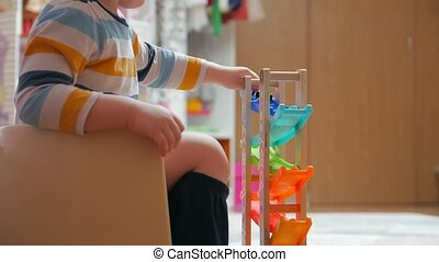 Child on a potty with toys childrens room home interior