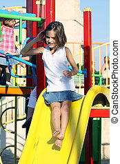 child on a slide