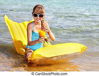 Child on beach.