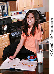 Child on countertop with milk