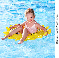Child on inflatable ring .